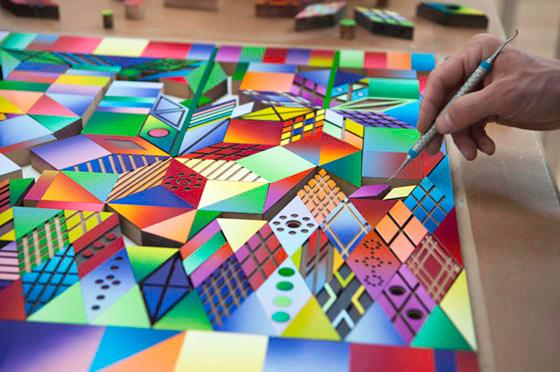 arranging the printmaking blocks with a tool